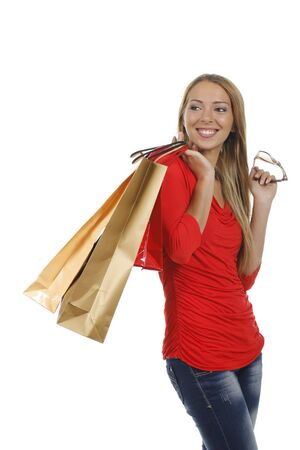 sales person: Young attractive woman with shopping bags isolated on white