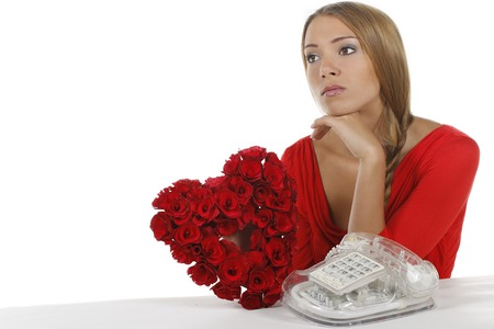 lovesickness: Sad woman waiting for a phone call isolated