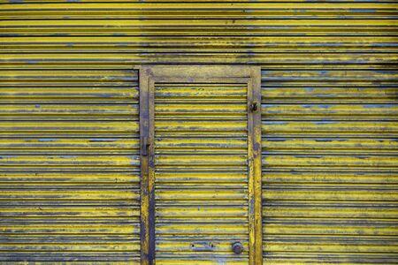 garage: Yellow old garage door outdoor