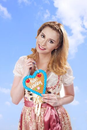 bred: Bavarian woman with dirndl and ginger bred smiling