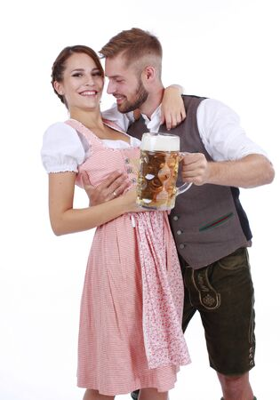 wiesn: Bavarian couple in traditional costume with beer and brezel