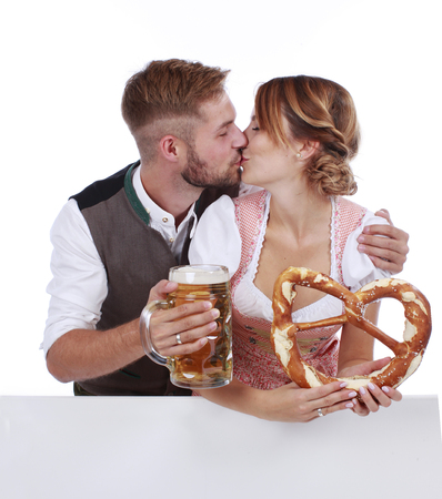 traditional costume: Bavarian couple in traditional costume with beer and brezel