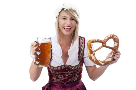 traditional costume: Bavarian woman with beer in traditional costume and bretzel