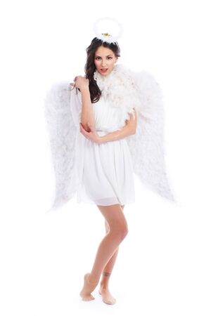 dark haired: Attractive dark haired angel isolated on white