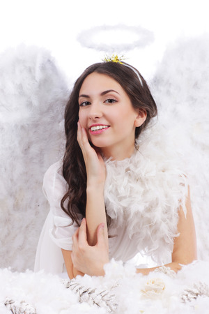 dark haired woman: Attractive dark haired angel whispering isolated
