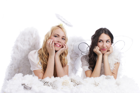 christmas costume: Two attractive guardian angel on a cloud isolated
