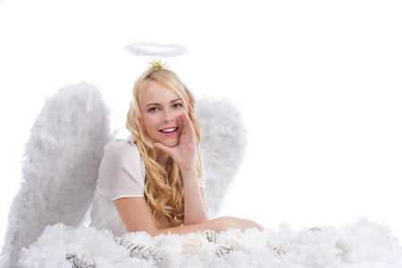 speak out: Attractive blonde angel whispering isolated