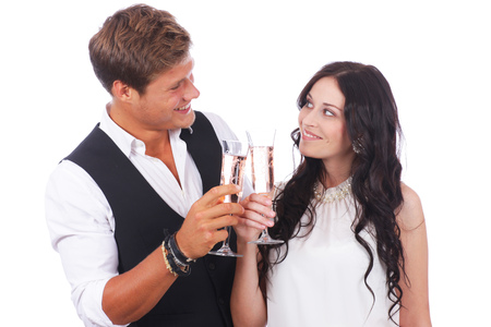 sparkling wine: Happy couple with sparkling wine glasses isolated