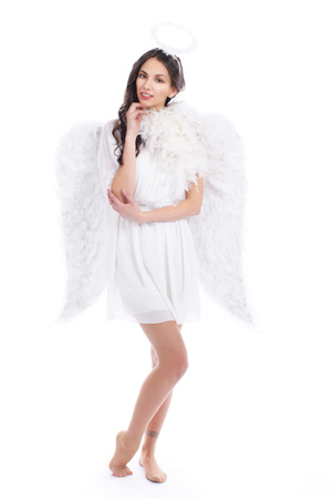 haired: Attractive dark haired angel isolated on white