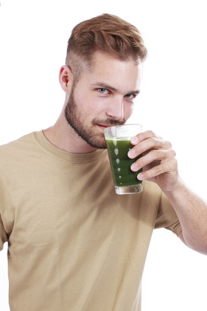 Man with green vegetable juice isolated Imagens