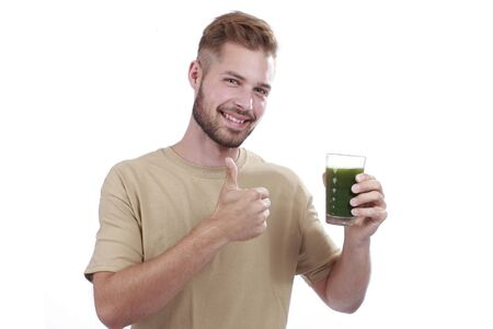 green vegetable: Man with green vegetable juice isolated Stock Photo
