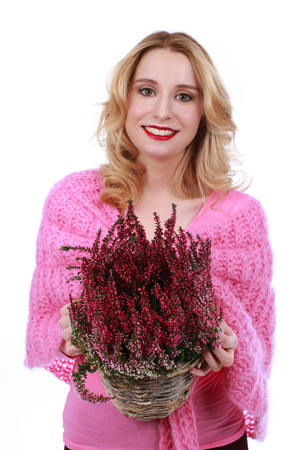 heather: Attractive young woman with heather flower isolated