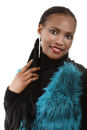 warm cloth: Attractive black african woman with art fur veste isolated smiling Stock Photo