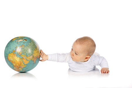 Cute baby touches globe isolated on white