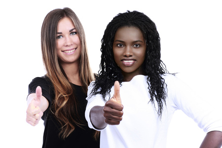 european integration: African woman and european woman together with thumbs up