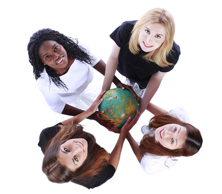 Four different multiracial woman holding a globe