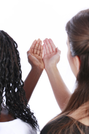 black hands: Woman holding white and black hands together