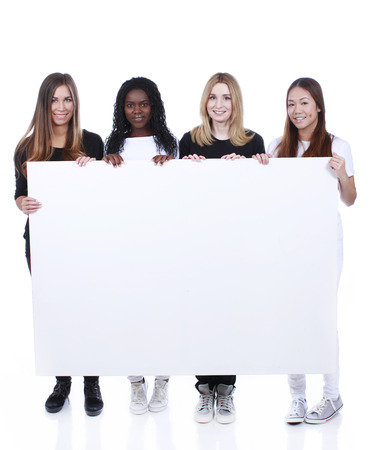 european integration: Multiracial team of young woman behind a white board Stock Photo
