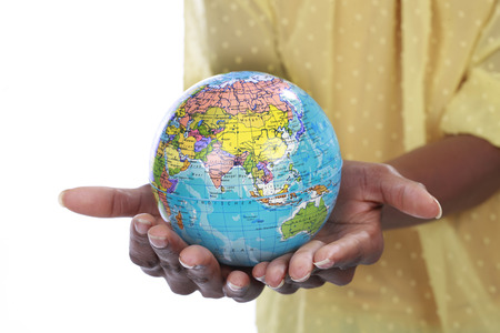 afroamerican: Black hands holding a globe Stock Photo