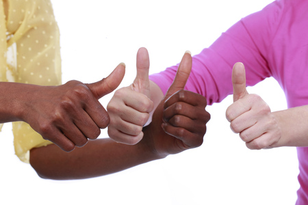 european integration: African and european woman have theirs thumbs up isolated Stock Photo