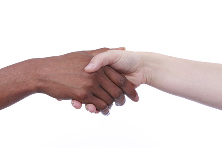 european integration: Handshake of african und european woman isolated Stock Photo