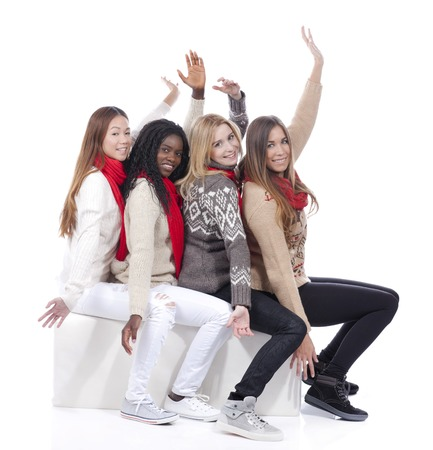 derivation: Four girlfriends with different derivation in a row with hands up isolated