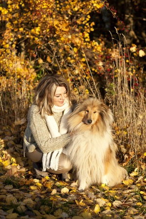 age forty: Middle age woman with collie dog  in autumn