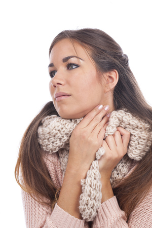 sore throat: Woman with sore throat and scarf isolated Stock Photo