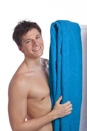stripped: Attractive young man stripped to the waist  with bathing towel
