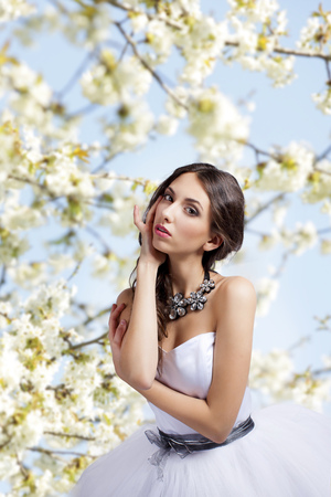 brunets: Attractive woman in front of flowering tree