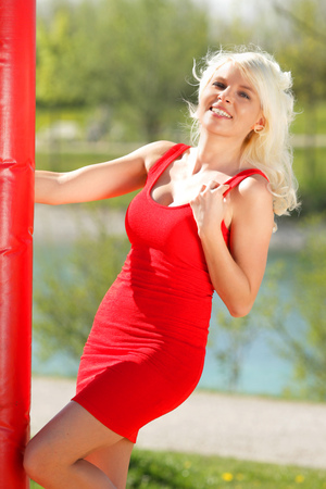 summer dress: Attractive young blond woman with red dress in summer Stock Photo