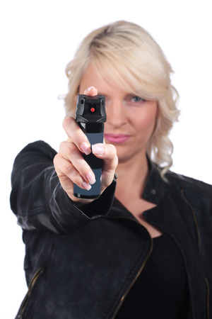 Woman with pepper spray for self defense Imagens
