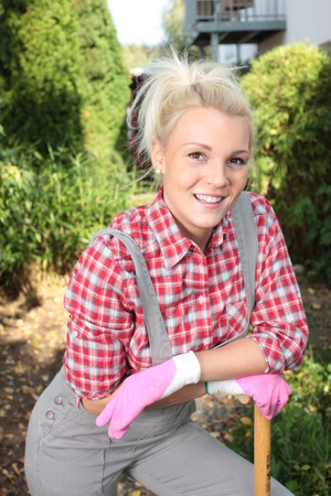 work clothes: Attractive woman with work clothes has a break from garden work