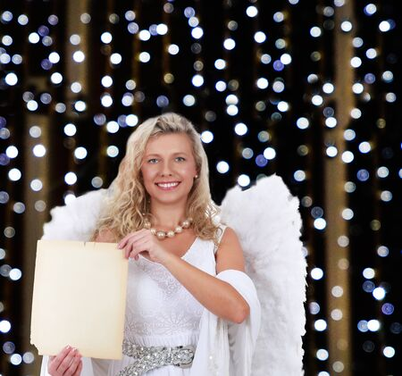 Attractive angel woman on christmas holding a wish list