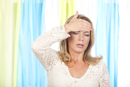 Woman with strong headache indoor