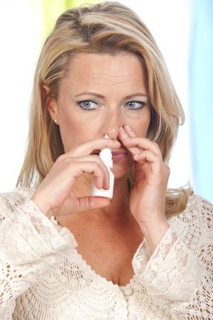 Woman with blocked nose applies nasal spray Stock fotó - 74267916