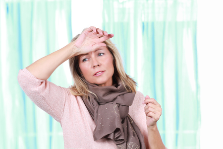 Mature woman with heat wave and headache Stockfoto