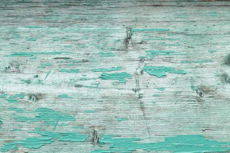 Turquoise wooden board with flaking color for background Stock Photo