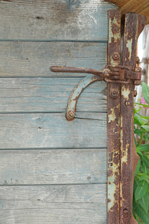 Wooden grey plank square pattern and rusty lock