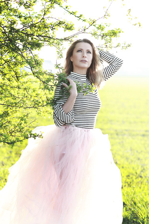 Attractive mature woman in spring time with petticoat skirt outdoor