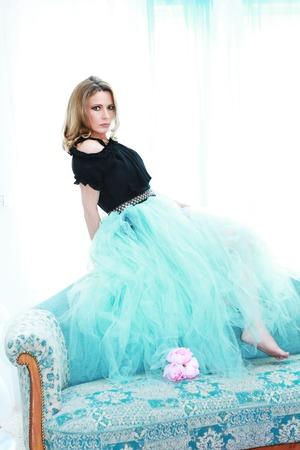 Attractive mature woman with petticoat skirt indoor 版權商用圖片