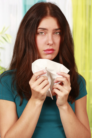 Sick woman with flu and handkerchief