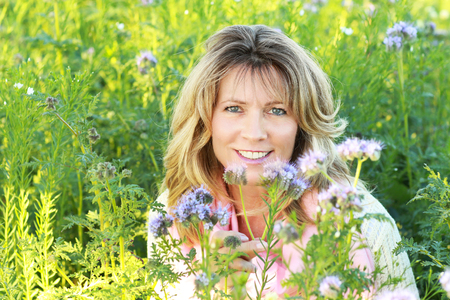 close up of a happy mature woman in nature