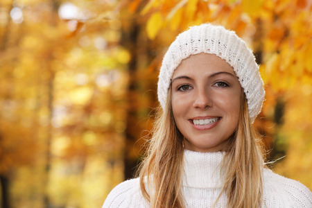 Happy woman stand in front of an autumnal wood Reklamní fotografie