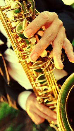 jazzy: man play on saxophone in nature instrumental blow jazz instrument