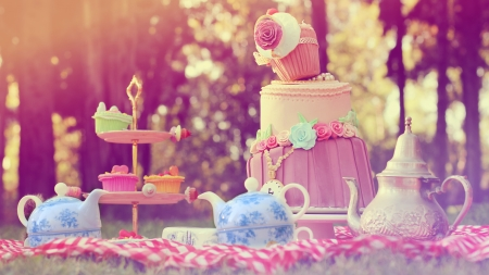 wonderland: cake meal dinner feast cupcakes kettle Stock Photo