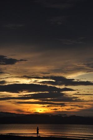 Wondama beach sunset with hill 5 Stock Photo