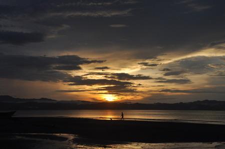 Wondama beach sunset with hill 4