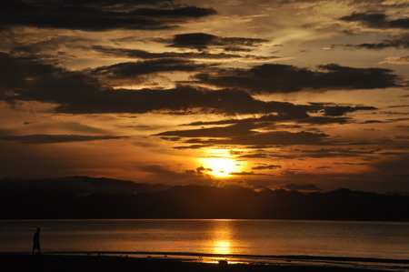 Wondama beach sunset with hill 2