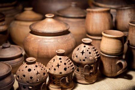 brown ceramic oil burner and a cup in the shop potter Foto de archivo